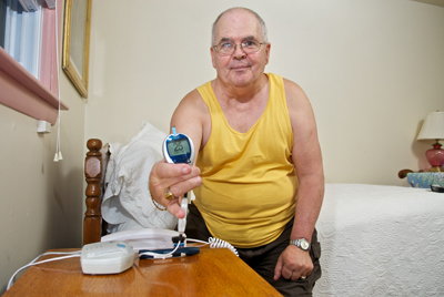 20100811 - Wednesday, August 11, 2010, Fairhaven, MA, USA – LIGHTCHASER PHOTOGRAPHY – Images of a Mass General Hospital diabetes patient in his own home using an advanced home monitoring system for the Partners HealthCare Center for Connected Health's 2010 Progress Report, Forward Currents.   ( lightchaser photography 2010 © image by j. kiely jr. )